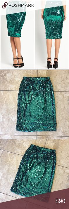 "Emerald Teal Green Sequin Pencil Skirt Medium New without tag! Green sequin pencil skirt by Kami Shade. Size M. No flaws. It's a deep emerald teal green. Depending on the lighting, it can take on more a blue tone or a forest green hue. It's simply gorgeous!  Very stretchy throughout. Slip-on style. Lined w/ fabric that feels silky to the touch.  The sequins are tear-drop paillettes. Approx 13"" across the elastic waist, unstretched & lying flat. Approx 25"" long. 95% poly 5% lycra. Smoke-free…"