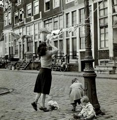 1950's. View of Zandhoek in Amsterdam. 1950's. The Zandhoek in Amsterdam is a street, or actually a quay, located at the Westerdok on the Realeneiland. The street, which connects the Grote Bickerstraat and Bokkinghangen, takes its name from sand ships mooring at the quay to unload their cargo. #amsterdam #1950 #Zandhoek