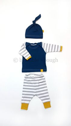 Another classic set, solids and stripes!  Would be perfect as a newborn outfit coming home from the hospital or for use everyday or even as a sweet baby gift for someone special.  This set includes grey and white knit pants with deep golden yellow cuffs, a dark teal, super soft knit shirt with a lap style neck for ease of putting on over babys head and taking off, striped sleeves, and a matching teal knot hat that is gentle and fits snug against your babies head. Your baby will look so…