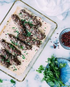 Lamb Kofta in Tahini Sauce. Warmly spiced lamb koftas baked in a creamy, lemony tahini sauce served with flatbread. The epitome of Middle Eastern comfort food. Lamb Recipes, Sauce Recipes, Meat Recipes, Cooking Recipes, Lebanese Recipes, Turkish Recipes, Ethnic Recipes, Lebanese Cuisine, Cooking