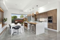 My new apartment/townhouses I just built at 4 Yorkshire st Pascoe Vale victoria, proudly designed and built by me! Modern rustic kitchen copper Tom Dixon pendant lights polished concrete floor marble Splashback timber and caesarstone Benchtop copper internal feature wall glass Splashback, professional pictures taken by Ray White realestate Brunswick