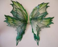 DIY Faerie Wings from Wire Hangers, Panty Hose, and Paint
