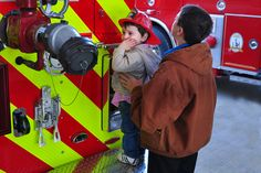 Visitors tour the engines on display during the Grand Opening of the Brunswick Volunteer Fire Station near Brunswick Crossing, a planned community in Brunswick, Maryland