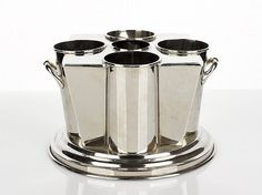 Buy online, view images and see past prices for French Art Deco Four Bottle Chrome Ice Bucket, c. Invaluable is the world's largest marketplace for art, antiques, and collectibles.