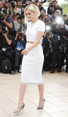 Kristen Stewart in Chanel paired with Christian Louboutin pumps attends the 'Cafe Society' photocall during the Cannes Film Festival. #bestdressed