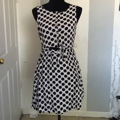 Cute and flirty polka dot dress! Cute and flirty polka dot dress with cutout and tie on the front Cotton Candy Dresses