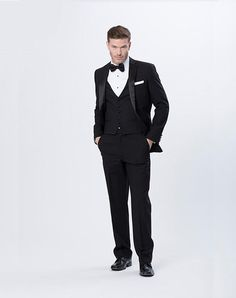 Featuring superior craftsmanship and 100% superfine lightweight wool, this single-breasted, 2-button, center-vented coat features a notch collar and is embellished with a dramatic black satin lapel and black satin-jetted pockets   Justin Alexander Men   https://www.theknot.com/fashion/justin-alexander-black-tux-justin-alexander-men-tuxedo