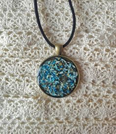 Blue petals resin necklace . Handmade with love by artmachi. Spring necklace, blue petals blue daisy, handmade resin and nature jewel