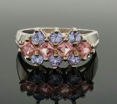 """There are some minor scratches on the ring.<br/><br/>Featured here is an elegant sterling silver vermeil band with four square cut pink Tourmaline, six. Amethyst round. Metal: Sterling Silver. Top Dimension: 1/4"""". Shank Dimension: 1/8"""". Stamp: 925, C^A. 