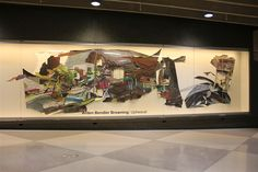 "Arden Bendler Browning, ""Upheaval"", 2012, acrylic gouache and Flashe on Tyvek (R) Vivia (TM) and wall, 91"" X 342"", Terminal E, Philadelphia International Airport."