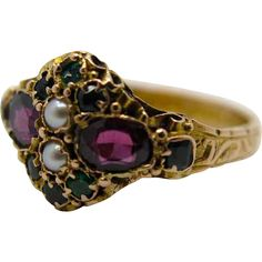 An English Antique Victorian 15k gold Ladies dress ring set with Amethysts cultured Pearls and beryls.The rings shank is highly decorated with chased scroll work foliage, overall a good Victorian quality Ladies dress ring.The ring is full hallmarked 15k Birmingham 1872.  http://www.rubylane.com/item/1202865-016/An-English-Antique-Victorian-15k-gold