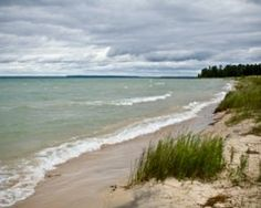 For $60 a night.. find peace on Lake Michigan beach frontage and a rustic cabin at Wilderness State Park north of Petoskey