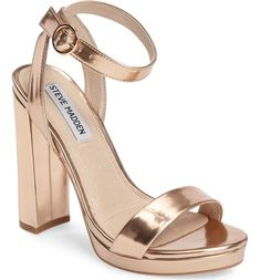 This essential strappy sandal in rose gold features a sky-high wrapped heel and a modest platform for added comfort.