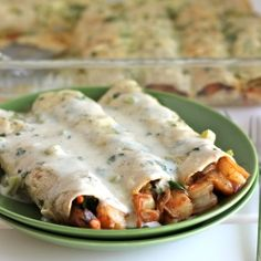 Roasted shrimp enchiladas packed with veggies and topped with an oh-so-creamy jalapeño cream sauce.