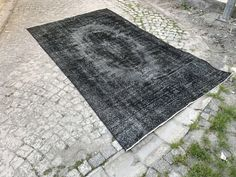 A personal favourite from my Etsy shop https://www.etsy.com/listing/522576141/anthracite-turkish-overdyed-vintage-rugs
