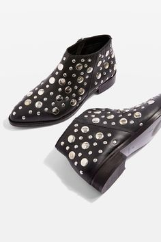These black leather boots have been pimped out with showers of eye-catching metal studs in various sizes. Featuring a low heel and soft toe point, the style is finished with a side zip fastening.