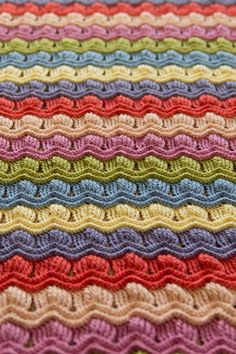 It's finished it's finished it's finished! :D I am SO happy with this blanket, seriously, I can't stop touching it and feeling it and snuggling up under it and spreading it out to gawk at all the gorgeous stripes… I'm … Continue reading →