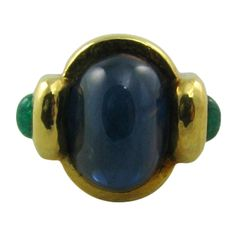 DAVID WEBB Cabochon Sapphire and Emerald Ring Set in Gold. | From a unique collection of vintage dome rings at http://www.1stdibs.com/jewelry/rings/dome-rings/