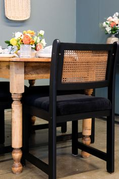 Upcycled dining chair.  A vintage cane chair is given a face lift with matte black paint and velvet seat.