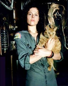 Sigourney Weaver as Ripley holding Jones (the cat) from the movie Alien, 1979.