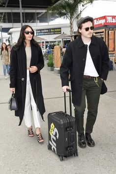 Brooklyn Beckham's Carry-On Luggage Is a Cult Favorite - Brooklyn Beckhams CarryOn Luggage Is a Cult Favorite - Fashion Couple, Look Fashion, Workwear Fashion, Mens Fashion, Dr. Martens, Olive Chinos, Dickies Pants, Brooklyn Beckham, Stylish Couple