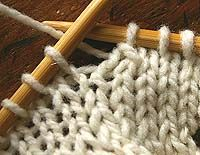 lift the slipped stitch over knitted stitch