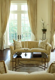 Sweeping silhouettes, luxe fabrics and embellishments such as tassels draw attention to traditional draperies. Panels — either straight or pleated, and with or without finials or tiebacks — and valances are old standbys. Simple plantation shutters work well too.
