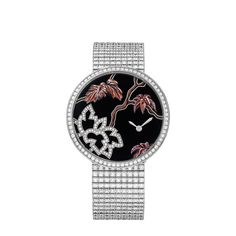 CARTIER. Les Indomptables de Cartier watch, quartz movement. Rhodiumized white gold set with brilliant-cut diamonds, dial set with 85 diamonds totaling 0.21 carats and black enamel, leaves and branches motif in enameled miniature painting, rhodiumized steel sword-shaped hands, rhodiumized white gold bracelet set with 594 brilliant-cut diamonds totaling 16.73 carats. Water-resistant to 3 bar (approx. 30 meters). Limited edition of 5 individually numbered pieces. #ÉtourdissantCartier #2015
