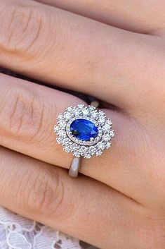 Sapphire engagement rings are very popular. Look our gallery of gorgeous engagement rings with sapphires that include unique, classic and modern styles. Floral Engagement Ring, Halo Diamond Engagement Ring, Vintage Engagement Rings, Beautiful Wedding Rings, Unique Rings, Wedding Ring Bands, Fine Jewelry, Jewellery, Sterling Silver Rings