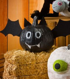 Turn a pumpkin into a bat for a fun Halloween decoration!