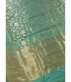 Sea Green Banarasi Katan Silk Saree---------------Sarees are the embodiment of Indian diversity and culture and has its own grace and charm. Beauty of a woman is further enhanced when she is clad in a saree. ------------Sarees from luxurionworld.com