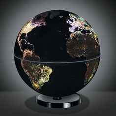 City Lights Globe  This rotating globe illuminates to show how the world's cities look at night from space. True to the view from orbit, the globe glistens with a soft white glow in major metropolitan areas throughout Eastern Europe and North America and has sparsely lit areas scattered throughout Africa and Russia.