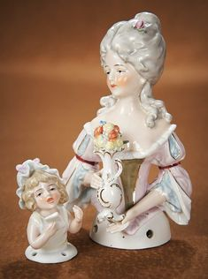 "The Vanity Fair - Strong Museum Half Dolls: 106 Two German Porcelain Half Dolls ""Lady with Vase of Flowers & Child with Letter"""