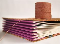 This technique would work nicely with manilla envelopes for storage of pictures, important papers etc. Back it with a spine board and covers and you could label them, too!