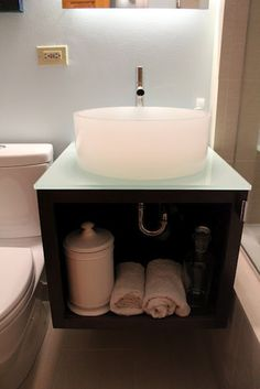Spa bathroom floating vanity by Andersonville Kitchen & Bath in Chicago