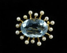 LOVE!  it looks so atomic age, even though it is a bit early for that.  Superb c1900 Antique 4ct + Natural Aquamarine Seed Pearl 14k Gold Watch Pin