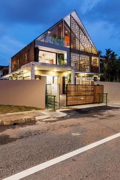 Lighting elevates the style quotient of the unique home in Singapore