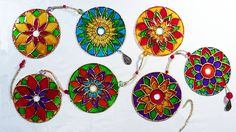 Mandala com CD - Mandala with CD How to remove the silver part on CD's and create something beautiful.