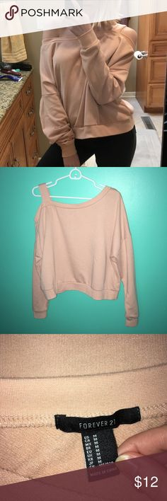 Forever21 New Peachy Cold Drop Shoulder Sweatshirt This super cute sweatshirt is a really trendy peach color and has only been worn a few times. I really like it but it isn't supposed to be off of both shoulders, just one. Off both shoulders is too daring for me and it would be better off on someone sizes 6 through 10.  ✨Welcome to my shop!  💘I love offers, questions, and discounting bundles  ✨Happy to provide additional pictures and measurements  💘All pre-loved items washed before sent…
