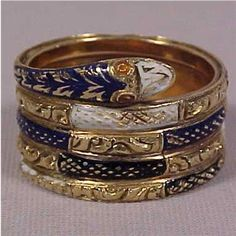 A gold and enamel Victorian ring in the form of a coiled snake, symbol of eternity.