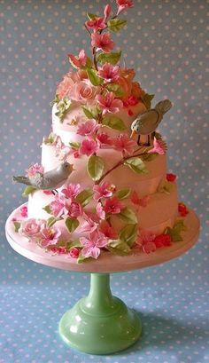 Pastel bird and blossom wedding cake by nice icing, via Flickr