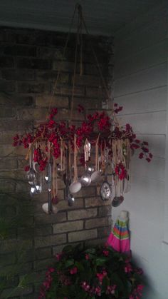 Metal spoon wind chimes decorated with berries
