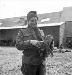 Rifleman R.A. Marshall, Queens Own Rifles of Canada, pointing out a hole in his helmet made by a German snipers bullet on D-Day. Bretteville-Orgueilleuse, France, 20 June 1944 by BiblioArchives / LibraryArchives, via Flickr