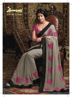 This gorgeous  Georgette material embroidered gray saree with black color border patta