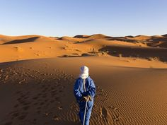 Picture of a Berber walking on a sand dune