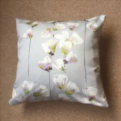 Zipped back cushion from a silky floral remnant