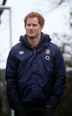Prince Harry watches the England squad go through their paces during the England Training Session at Pennyhill Park on 19.03.2015 in Bagshot, England.