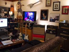 Amp and guitar room. Not the design but could definitely have a guitar room with amps, a mac, logic, and guitars.