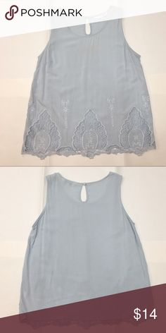 Sleeveless Swing Top w/ Lace Detail Lovely light blue sleeveless swing top with lace detail lining the bottom. Worn but in great condition with no apparent damage. Reasonable offers accepted! Bundle and save! Charming Charlie Tops Blouses