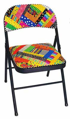 from Scrap-o-later book :  huh - what an idea.  I have a folding chair.  I could try this.  And a little paint on the metal wouldn't hurt either!